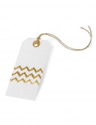 8 etichette bianche con zig zag oro