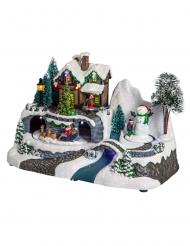 Villaggio di Natale luminoso con casetta