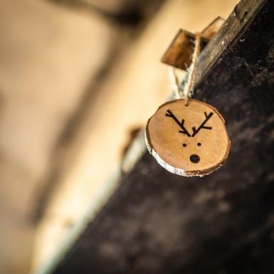Rondella di legno con testa di renna-1